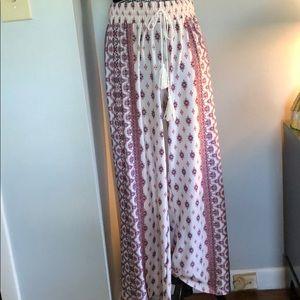 Cream with pink and blue design palazzo pants.